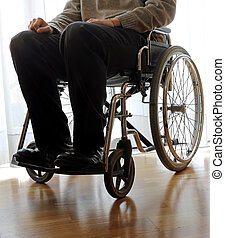 disabled elderly in a wheelchair in the room - disabled...