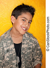 Hispanic Boy - Handsome young Hispanic in front of yellow...