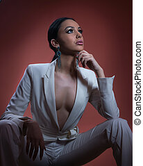 Young beautiful brunette woman in elegant white suit with...