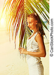 Woman near palm tree