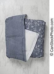 Folded Dark Gray Duvet with Floral Accents and Underside...
