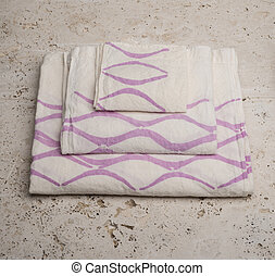 Stack of Towels with Purple Concave Lines at High Angle