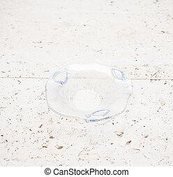 A Tiny Crystal Ashtray with Blue Fish Design - A tiny empty...