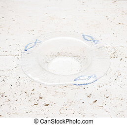A Crystal Ashtray with Blue Fish Design - An empty crystal...