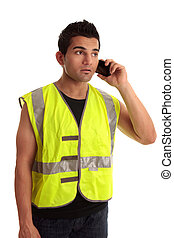 Builder tradesman takes a call