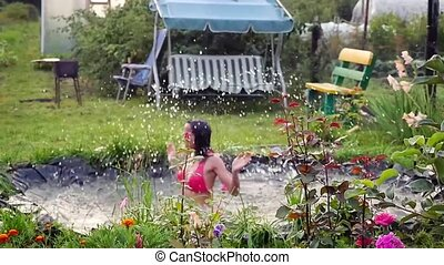 In the summer, bright sunny day, young woman is bathed...