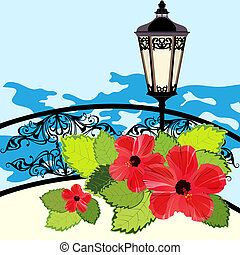 Tropical coastline with lantern, fence and flowers