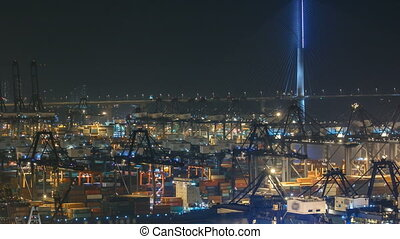 Hong Kong Container Terminal at Night timelapse with bridge...