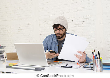 hispanic attractive hipster businessman working at home office using mobile phone