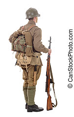 young Soviet soldier with rifle on the white background - a...