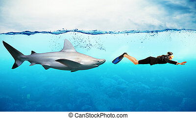 Enemy from behind - Shark swims behind a woman with mask