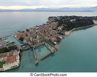 Aerial view of the Scaliger Castle in Sirmione by lake...