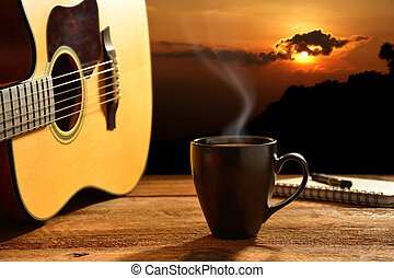 Coffee - Cup of coffee and guitar with the sun in background