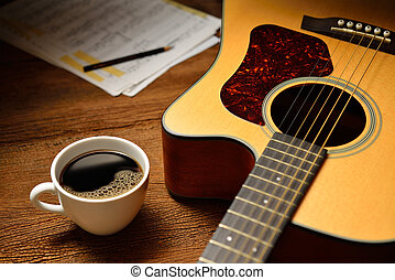 Coffee - Cup of coffee and guitar on wooden table