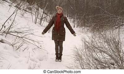 Girl doing a respiratory exercise in the winter forest.