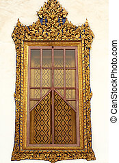 Golden carving wooden window of Tha