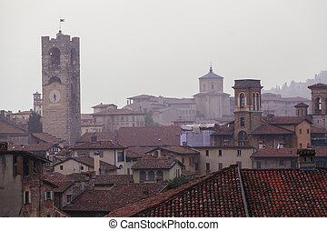 Bergamo bell tower and house roofs