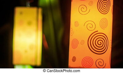 Closeup Cylindrical Chinese Lanterns in Dark Night - closeup...