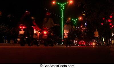 Scooter Car Night Traffic along City Street in Vietnam - NHA...