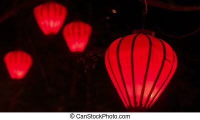 Closeup Red Chinese Lit Lanterns in Dark Night Sky - closeup...