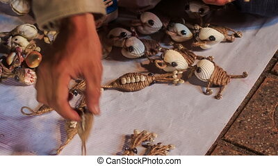Woman Sets Hand-made Shell Souvenirs in Vietnam - woman...