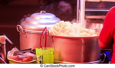 Closeup Vietnamese Street Fast Food Stew-pans at Night -...