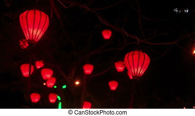 Red Chinese Lit Lanterns in Dark Night Sky - wind shakes...