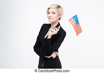 Smiling businesswoman holding USA flag isolated on a white...