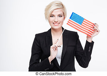 Beautiful businesswoman holding USA flag isolated on a white...