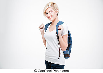 Happy female student with backpack standing isolated on a...
