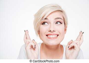 Smiling woman with fingers crossed gesture - Closeup...