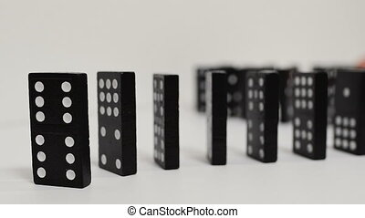 domino effect, black wooden domino line curve. Isolated on...