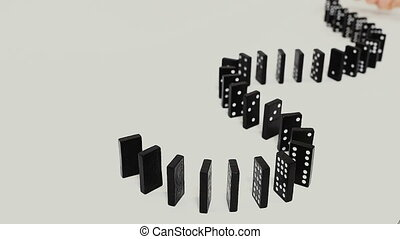 row of dominoes with one falling over Isolated on gray...