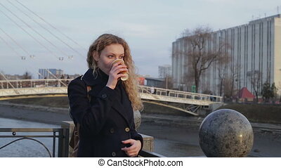 Girl on a walk with a hot drink - girl on a walk with a hot...