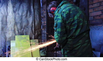 Man Working With Angle Grinder - Worker with Angle Grinder...