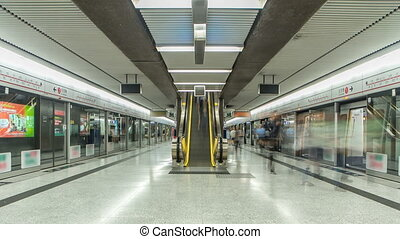 Subway train station interior timelapse in Central, Hong Kong. MTR is the most popular transport in Hong Kong