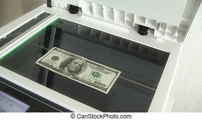 photocopy of hundred dollar bills on a copier