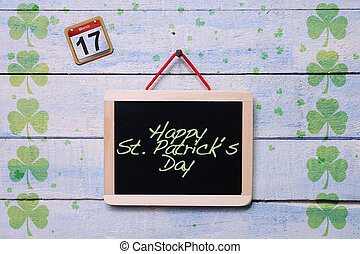 St. Patrick Day. - Blackboard hanging on a old wooden wall...