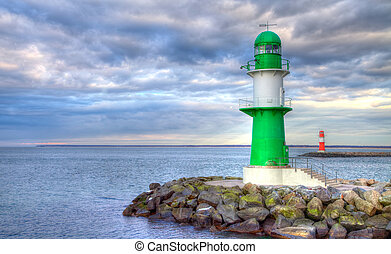 two german lighthouses on stones at sea