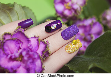 Manicures in the colors of violets. - Multicolored manicure...