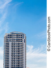 White Condo Tower Under Blue Tropical Sky