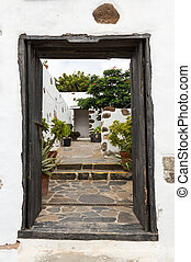 Old black entrance gate in Betancuria village on on...