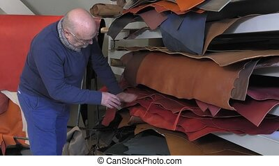 leather goods master craftsman - choice of grain and color...