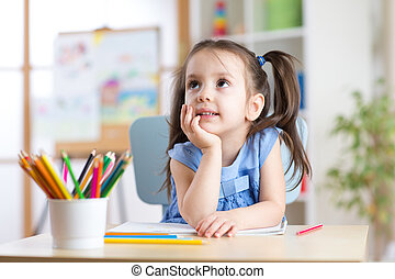 dreamy kid girl with pencils in day care center - dreamy kid...