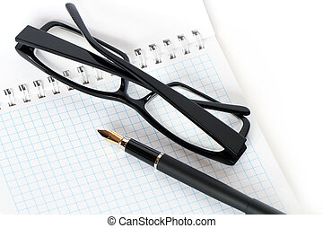 Pen And Spectacles - Closeup of fountain pen and black...