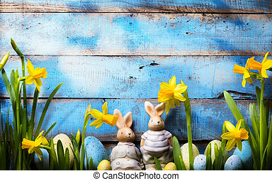 art Easter holidays background; family Easter bunny and Easter eggs