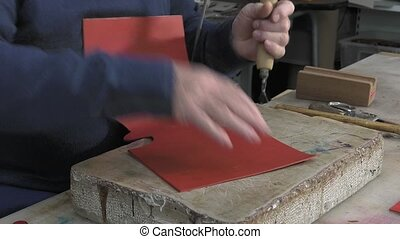 leather goods master craftsman - marking the contours of...