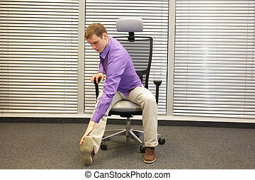 healthy lifestyle in office work - man exercising on chair...