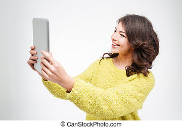 Smiling casual woman using tablet computer