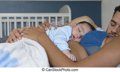 Nap time with mummy and daddy - Baby boy having a nap with...